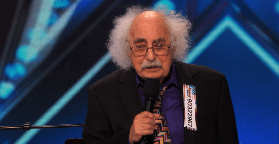 Einstein lookalike Ray Jessel sings a humorous song for the crowd