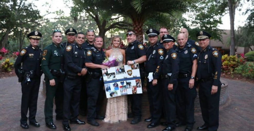Police Officers escort daughter of their fallen colleague